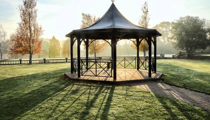 Band stand in Walton park wakefield, with autumn backdrop and sun beaming through